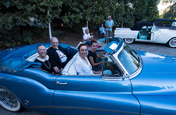roy lave and family in a blue car